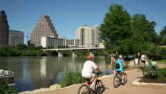 walkers, joggers and cyclists enjoy the lady bird lake trail, austin - stock footage
