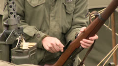 Soldier loading gun Stock Footage