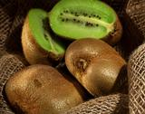 Stock Photo of kiwi fruit on the burlap textile still life
