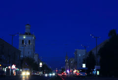 Central avenue of Zaporizhzhya at evening with flare up lanterns timelapse Stock Footage