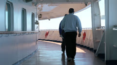 Passenger and crew walk cruise ship deck for exercise HD 7828 Stock Footage