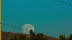 HD 30p  wide Supermoon 2013 rising over ridge near Tucson AZ Time Lapse Stock Footage