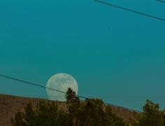 Stock Video Footage of 4K 24pfilm wide Supermoon 2013 rising over ridge near Tucson AZ Time Lapse