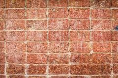 Red stone wall texture for background Stock Photos
