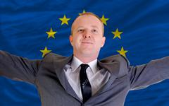 happy businessman because of profitable investment in europe standing near fl - stock photo