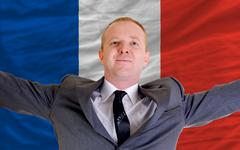 Stock Photo of happy businessman because of profitable investment in france standing near fl