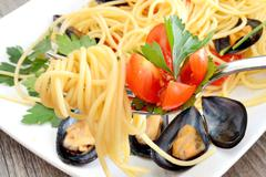 spaghetti with reef mussels - stock photo