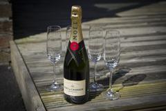 Moët & Chandon Champagne & 4 Glasses - stock photo