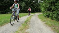 Family trip on bicycles, mother with two sons riding bike Stock Footage