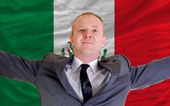 happy businessman because of profitable investment in mexico standing near fl - stock photo