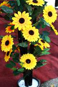 plastic decorative sunflower sales during festive season. - stock photo