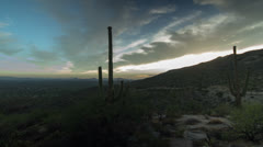 HD 30p slider time lapse of Saguaro cactus ridge with sun setting and clouds Stock Footage