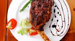 On wooden plate : roast shoulder Stock Footage