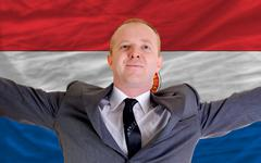 Stock Photo of happy businessman because of profitable investment in paraguay standing near