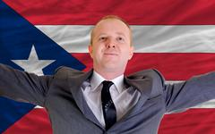 happy businessman because of profitable investment in puertorico standing nea - stock photo
