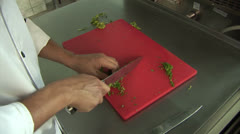 The cook prepares. Cook chopped green Stock Footage