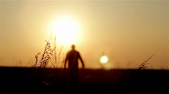 Stock Video Footage of Silhouette of man on the sunrise. Freedom concept. Harmony concept.