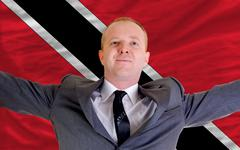 happy businessman because of profitable investment in trinidad tobago standin - stock photo