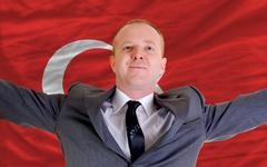 happy businessman because of profitable investment in turkey standing near fl - stock photo