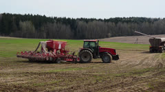 Tractor sowing cereals. Agricultural machinery for planting cereals Stock Footage