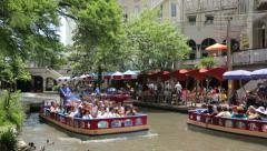 Tourists taking a boat ride along the san antonio riverwalk, texas, usa Stock Footage