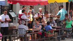 Mariachi band plays for tourists at restaurants on san antonio riverwalk Stock Footage