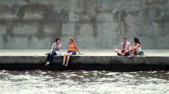 Resting of youth on the embankment Moscow River. Russia. Stock Footage