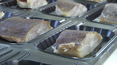 Chopped fish on the assembly line. Vacuum packing fish Stock Footage