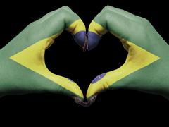Stock Photo of heart and love gesture by hands colored in brazil flag for tourism