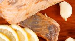 Healthy fish cuisine : baked pink salmon steaks Stock Footage