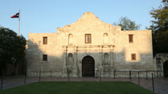 The texan flag flies over the alamo on a sunny day, san antonio, texas, usa Stock Footage