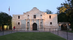 tourists visit the alamo at dusk, san antonio, texas, usa - stock footage