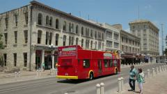 a tour bus passes alamo plaza on a sunny day, san antonio texas, usa - stock footage