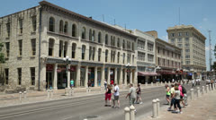 tourists enjoy a sunny summers day in alamo plaza, san antonio texas, usa - stock footage