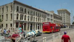 a tour bus and horse and carriage pass alamo plaza - stock footage
