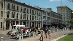 Horse and carriage passes alamo plaza on a sunny day, san antonio texas, usa Stock Footage