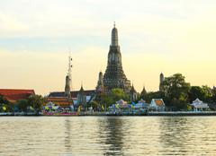 wat arun, the temple of dawn, stands on the chao phraya river in bangkok - stock photo