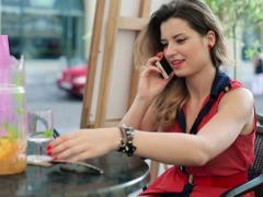 Beautiful woman talkin on cellphone in cafe NTSC Stock Footage