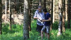 Father and son with optical rifle in the woods episode 7 Stock Footage