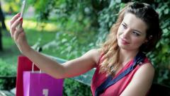 Pretty woman taking photo of herself with cellphone HD - stock footage
