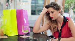 Sad beautiful woman sitting in cafe HD Stock Footage