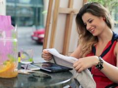 Pretty woman checking her just bought clothes NTSC - stock footage