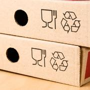 Two boxes of pizza with the recycling symbol. Stock Photos