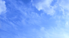Time lapse clip of white fluffy clouds over blue sky Stock Footage
