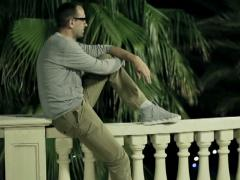 Happy man sitting in the evening in the tropical garden Stock Footage