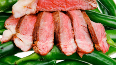 meaty food : grilled meat steak sliced hot chili peppers - stock footage