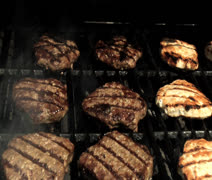 Zoom into burgers & turkey burgers Stock Footage