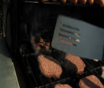 Stock Video Footage of flipping beef and turkey burgers on grill