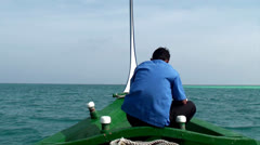 The boat Dhoni with the guy in the open Indian Ocean. Maldives. Stock Footage