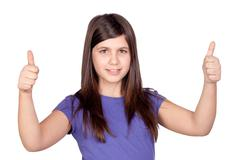 Adorable preteen girl accepting with the tumbs Stock Photos